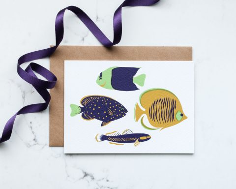 An illustrated greeting card of tropical fish