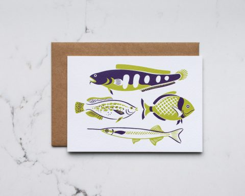 An illustrated card featuring green and purple fish
