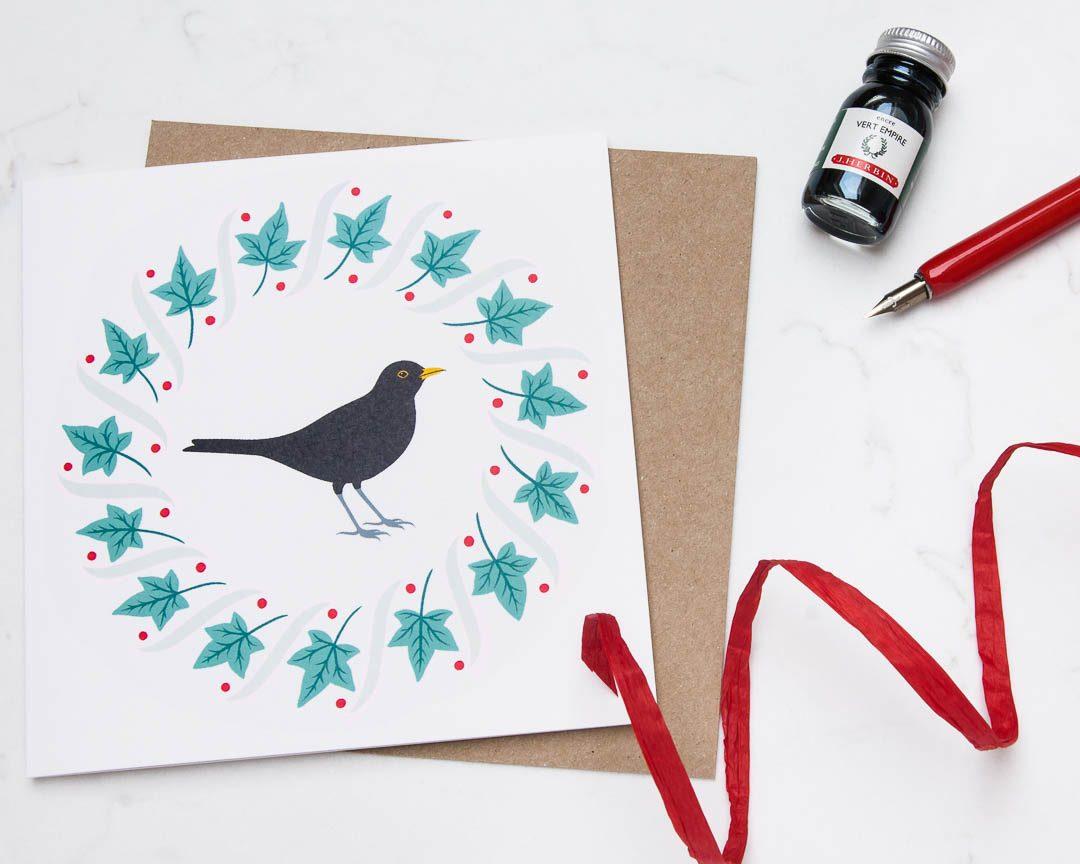blackbird and winter wreath greeting card