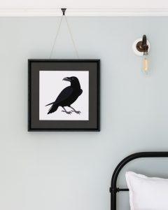 A raven giclée print in a frame