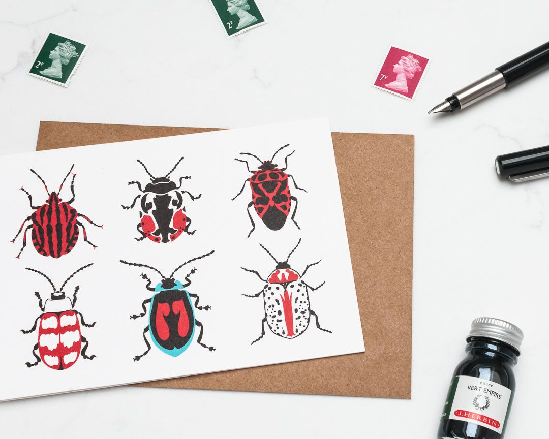 A greeting card illustration of beetles