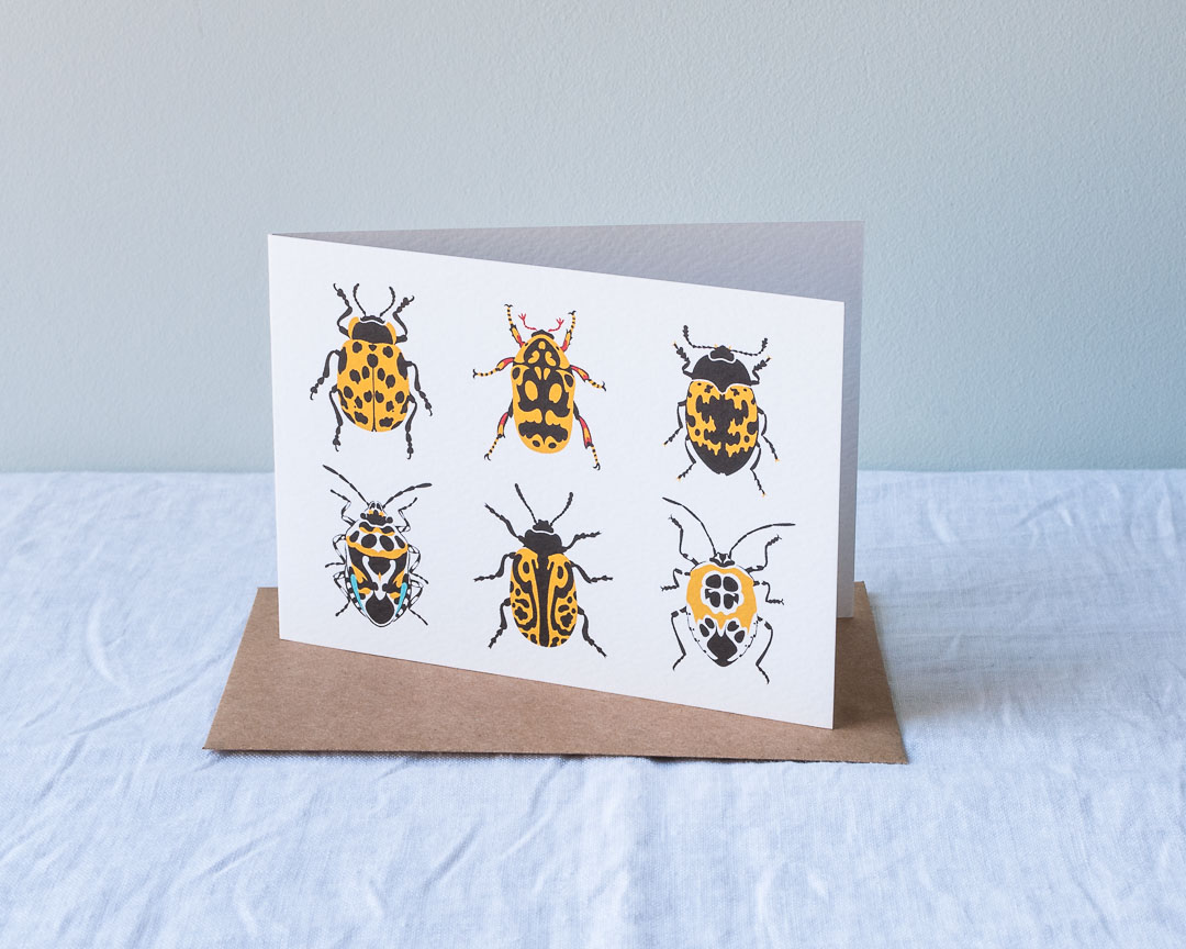 An illustrated card of bright yellow beetles