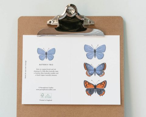 Greeting card with three blue butterflies