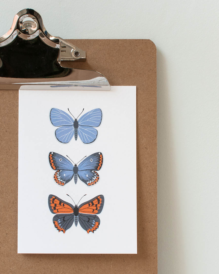 A greeting card with three blue butterflies by Persephone Coelho