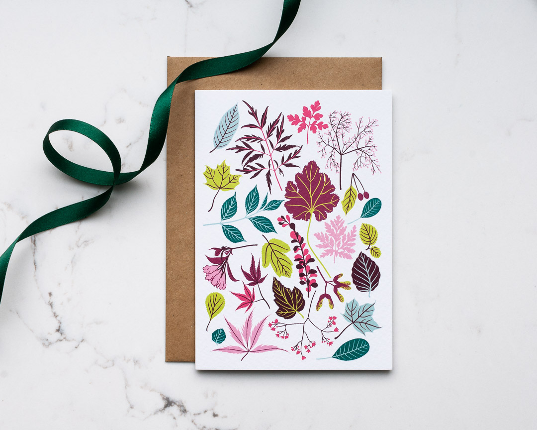 An illustrated greeting card of flowers and leaves
