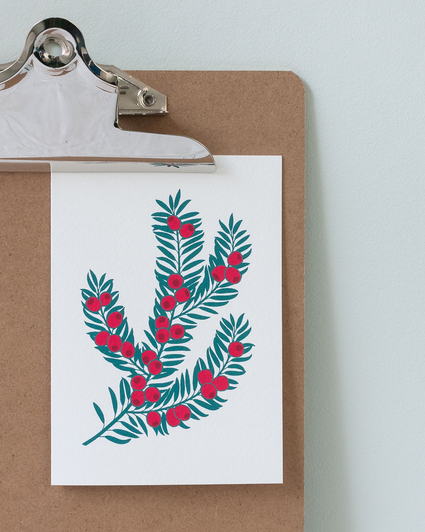 A Christmas card featuring a branch of yew