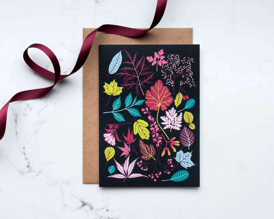 An illustrated greeting card of leaves and flowers